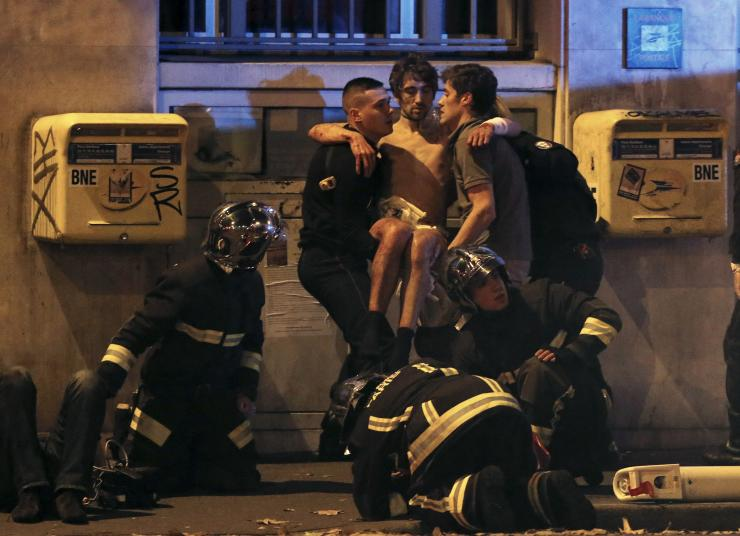 security-services-carry-away-injured-man-after-paris-attacks